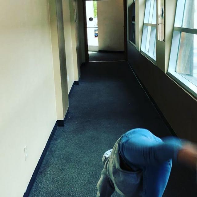 Lainey goofing off down a hallway on her hands. #Gymnastics #Geek